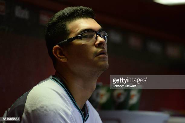 Anthony Banda of the Arizona Diamondbacks sits in the dugout in the MLB game against the Houston Astros at Chase Field on August 15 2017 in Phoenix...
