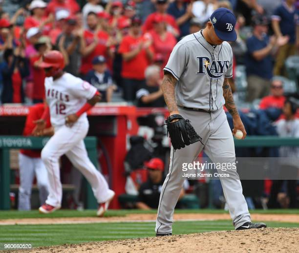 Anthony Banda of the Tampa Bay Rays stands on the pitchers mound as Martin Maldonado of the Los Angeles Angels of Anaheim rounds the bases after a...