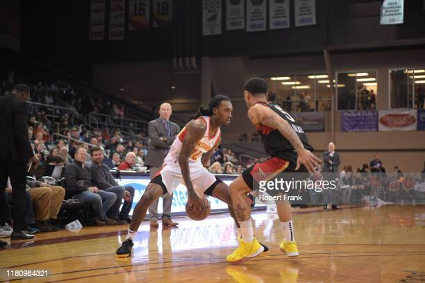 Anthony Barber looks to drive against Josh Gray of the Erie BayHawks during a G League game between the Erie BayHawks and the College Park SkyHawks...