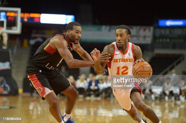 Anthony Barber of the College Park SkyHawks drives against Javon Bess of the Erie BayHawks a G League game between the Erie BayHawks and the College...