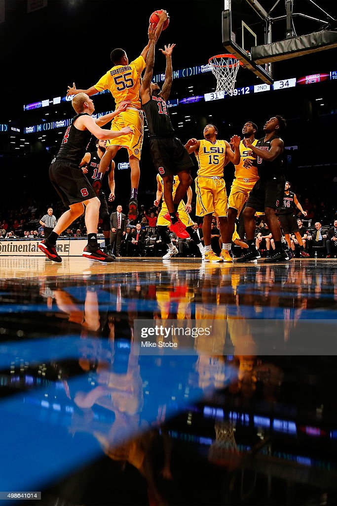 Anthony Barber #12 of the North Carolina State Wolfpack defends the net against Tim Quarterman #55 of the LSU Tigers at Barclays Center on November 24, 2015 in Brooklyn borough of New York City.