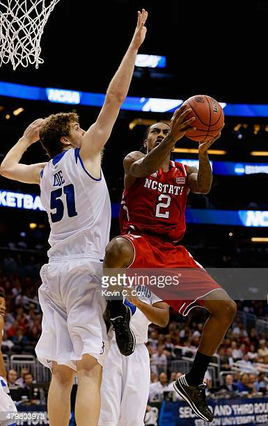 Anthony Barber of the North Carolina State Wolfpack makes a layup in the first half against Rob Loe of the Saint Louis Billikens during the second...