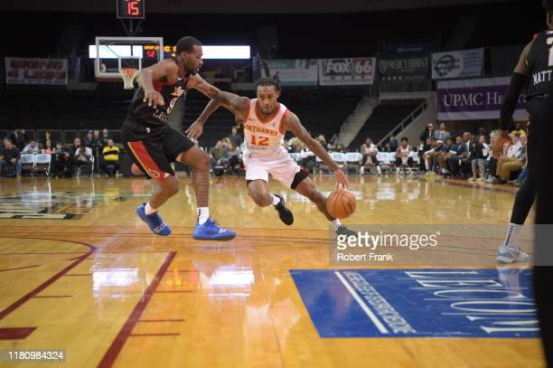 Anthony Barber#12 of the College Park SkyHawks drives against Javon Bess of the Erie BayHawks during a G League game between the Erie BayHawks and...