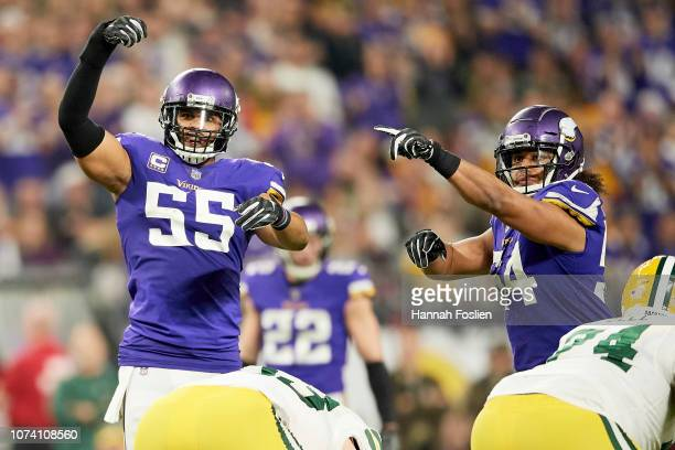Anthony Barr and Eric Kendricks of the Minnesota Vikings celebrate a delay of game penalty against the Green Bay Packers during the game at U.S. Bank...