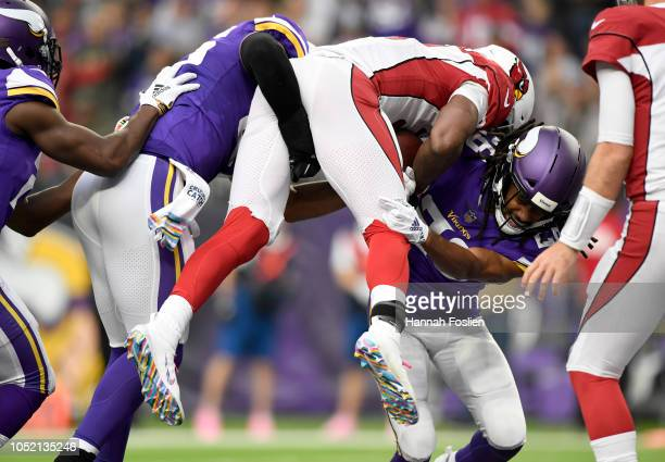 Anthony Barr and Trae Waynes of the Minnesota Vikings combine to tackle David Johnson of the Arizona Cardinals in the third quarter of the game at US...