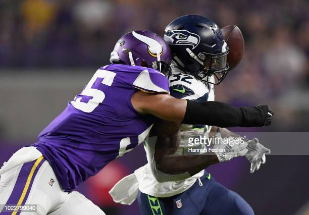 Anthony Barr of the Minnesota Vikings breaks up a pass intended for Chris Carson of the Seattle Seahawks during the second quarter in the preseason...