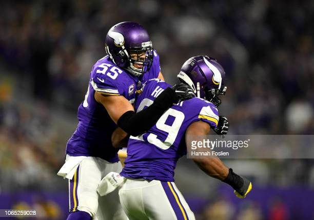 Anthony Barr of the Minnesota Vikings celebrates with Danielle Hunter after he made a tackle in the third quarter of the game against the Green Bay...
