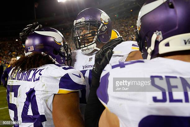 Anthony Barr of the Minnesota Vikings celebrates with Eric Kendricks and Andrew Sendejo after defeating the Green Bay Packers at Lambeau Field on...