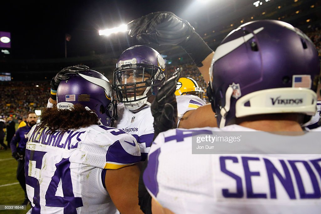 Anthony Barr #55 of the Minnesota Vikings celebrates with Eric Kendricks #54 and Andrew Sendejo #34 after defeating the Green Bay Packers at Lambeau Field on January 3, 2016 in Green Bay, Wisconsin. The Minnesota Vikings defeated the Green Bay Packers with a score of 20 to 13.