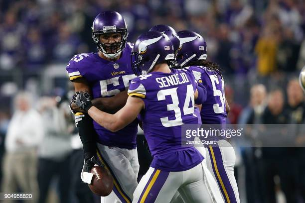 Anthony Barr of the Minnesota Vikings celebrates with Eric Kendricks and Andrew Sendejo after a interception against the New Orleans Saints during...