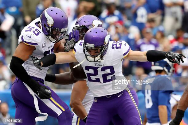 Anthony Barr of the Minnesota Vikings celebrates with Harrison Smith after tackling Jon Hilliman of the New York Giants in the end zone for a safety...