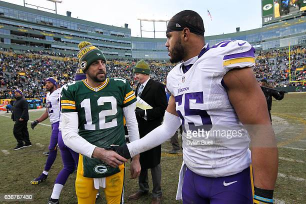 Anthony Barr of the Minnesota Vikings meets with Aaron Rodgers of the Green Bay Packers after the Green Bay Packers beat the Minnesota Vikings 3825...