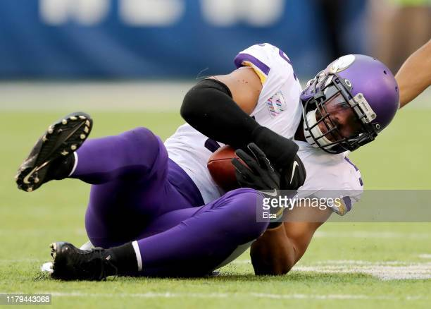 Anthony Barr of the Minnesota Vikings picks off a pass intended for Golden Tate of the New York Giants in the fourth quarter at MetLife Stadium on...