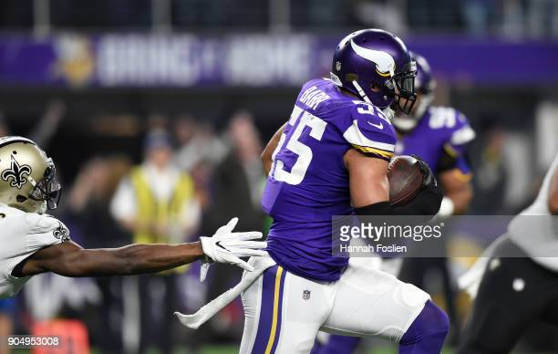 Anthony Barr of the Minnesota Vikings runs with the ball after intercepting Drew Brees of the New Orleans Saints in the second quarter of the NFC...