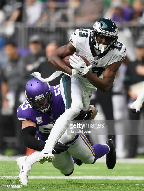 Anthony Barr of the Minnesota Vikings tackles Nelson Agholor of the Philadelphia Eagles during the second quarter of the game at U.S. Bank Stadium on...