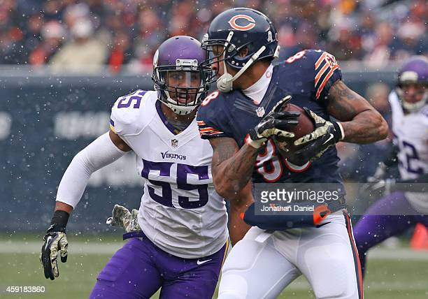 Anthony Barr of the Minnesota Vikings tries to tackle Dante Rosario of the Chicago Bears during the first half of a game at Soldier Field on November...