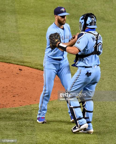 Anthony Bass of the celebrates with Reese McGuire of the Toronto Blue Jays after the game against the Miami Marlins at Marlins Park on September 02,...
