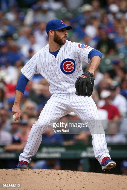Anthony Bass of the Chicago Cubs pitches in the eighth inning against the Los Angeles Dodgers at Wrigley Field on June 20 2018 in Chicago Illinois
