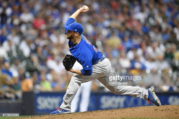 Anthony Bass of the Chicago Cubs throws a pitch during the eighth inning of a game against the Milwaukee Brewers at Miller Park on June 12 2018 in...