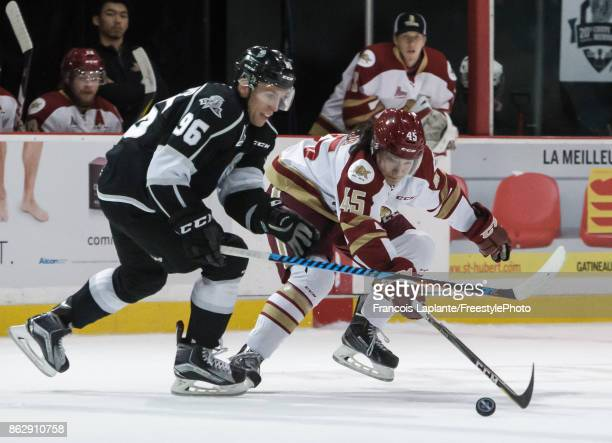 Anthony Beauchamp of the Gatineau Olympiques skates with the puck against Elijah Francis of the Acadie-Bathurst Titan on October 18, 2017 at Robert...