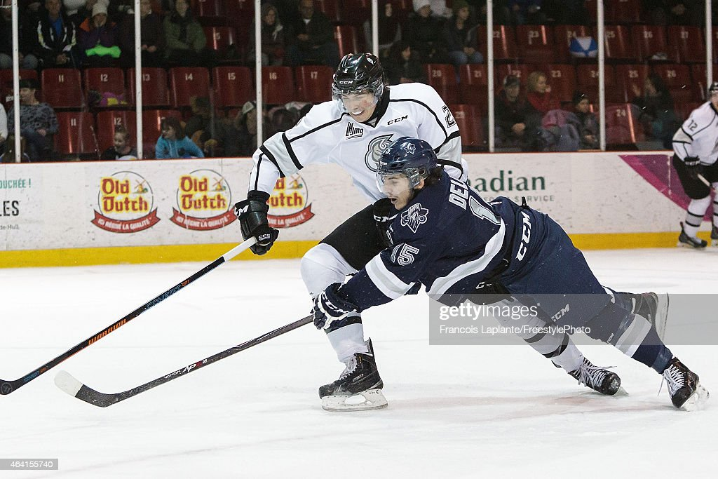 Anthony Beaulieu #2 of the Gatineau Olympiques defends against Anthony DeLuca #15 of the Rimouski Oceanic on February 22, 2015 at Robert Guertin Arena in Gatineau, Quebec, Canada.