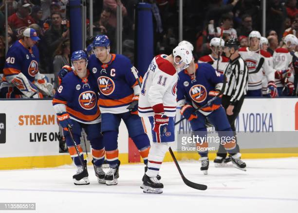 Anthony Beauvillier and Anders Lee of the New York Islanders celebrate their 21 victory over v1#2 and the Montreal Canadiens at NYCB Live's Nassau...