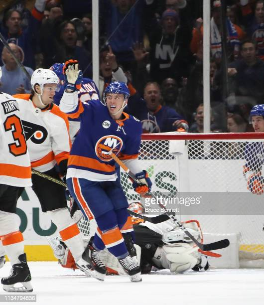Anthony Beauvillier of the New York Islanders celebrates a first period goal by Scott Mayfield against the Philadelphia Flyers at NYCB Live's Nassau...