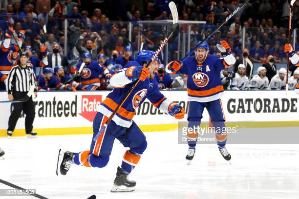 Anthony Beauvillier of the New York Islanders celebrates after scoring the game-winning goal during the first overtime period against the Tampa Bay...