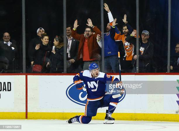 Anthony Beauvillier of the New York Islanders celebrates his game winning goal against the Dallas Stars in overtime at Barclays Center on February 04...