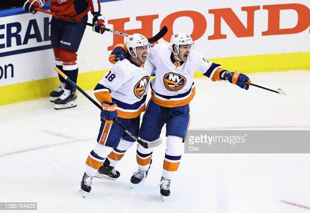 Anthony Beauvillier of the New York Islanders celebrates his goal at 1155 of the third period against the Washington Capitals and is joined by Mathew...