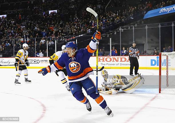 Anthony Beauvillier of the New York Islanders celebrates his goal against Matt Murray of the Pittsburgh Penguins at 234 of the second period at the...