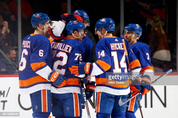 Anthony Beauvillier of the New York Islanders celebrates his secondperiod goal against the Philadelphia Flyers with teammates Ryan Pulock Thomas...