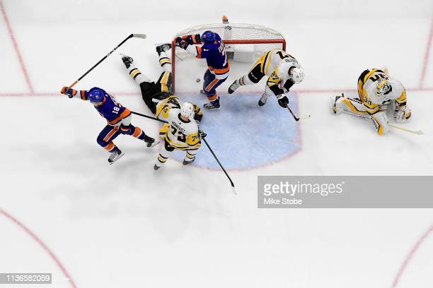 Anthony Beauvillier of the New York Islanders celebrates his second period goal as Matt Murray of the Pittsburgh Penguins reacts in Game Two of the...
