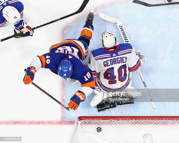 Anthony Beauvillier of the New York Islanders celebrates his third period goal against Alexandar Georgiev of the New York Rangers at NYCB Live's...
