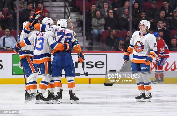 Anthony Beauvillier of the New York Islanders celebrates with teammates after scoring a goal against the Montreal Canadiens in the NHL game at the...