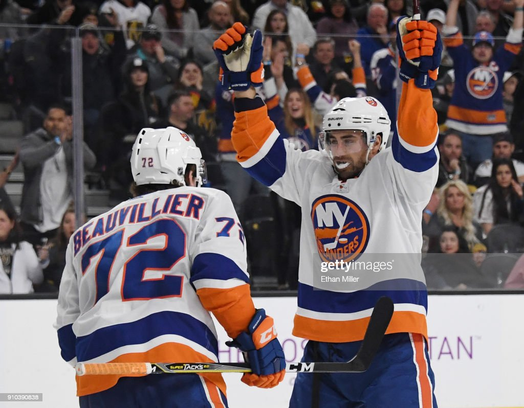 Anthony Beauvillier #72 of the New York Islanders celebrates with teammate Jordan Eberle #7 after Beauvillier assisted Eberle on a third-period goal against the Vegas Golden Knights during their game at T-Mobile Arena on January 25, 2018 in Las Vegas, Nevada. The Islanders won 2-1.