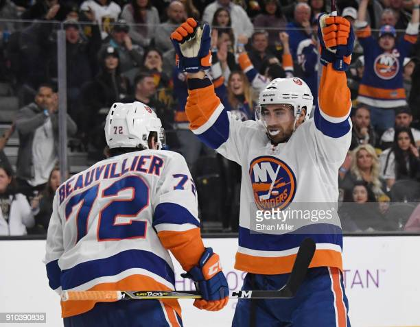 Anthony Beauvillier of the New York Islanders celebrates with teammate Jordan Eberle after Beauvillier assisted Eberle on a thirdperiod goal against...