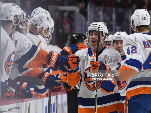 Anthony Beauvillier of the New York Islanders celebrates with the bench after scoring a goal against the Montreal Canadiens in the NHL game at the...