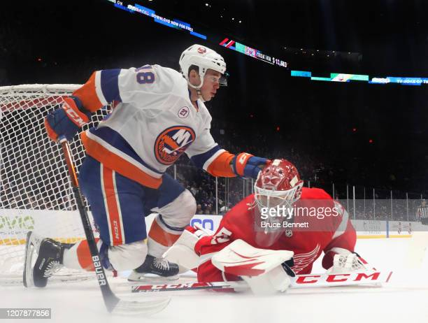 Anthony Beauvillier of the New York Islanders collides with Jonathan Bernier of the Detroit Red Wings during the first period at the NYCB Live's...