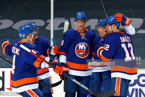 Anthony Beauvillier of the New York Islanders is congratulated by his teammates after scoring a goal against the Boston Bruins during the third...