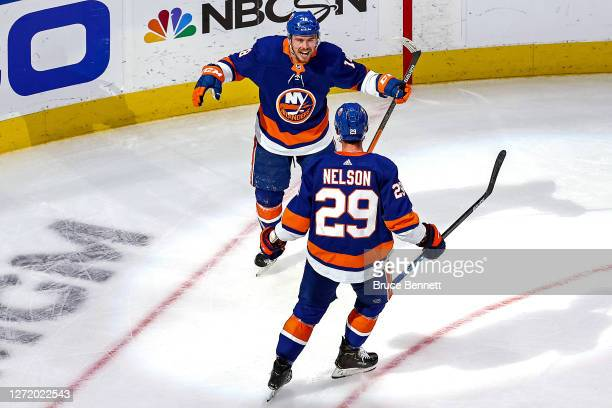 Anthony Beauvillier of the New York Islanders is congratulated by Brock Nelson after scoring a goal against the Tampa Bay Lightning during the second...