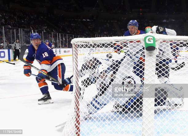 Anthony Beauvillier of the New York Islanders scores a goal at 125 of the third period against Laurent Brossoit of the Winnipeg Jets at NYCB Live's...