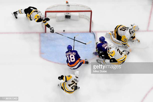 Anthony Beauvillier of the New York Islanders scores a second period goal past a diving Erik Gudbranson of the Pittsburgh Penguins in Game Two of the...