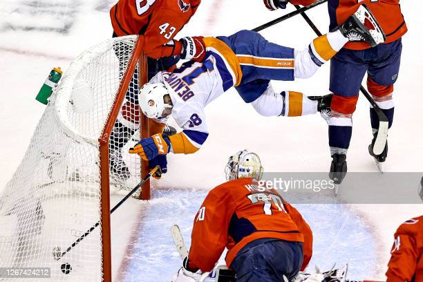 Anthony Beauvillier of the New York Islanders scores his second goal of the game past Braden Holtby of the Washington Capitals as he is checked into...