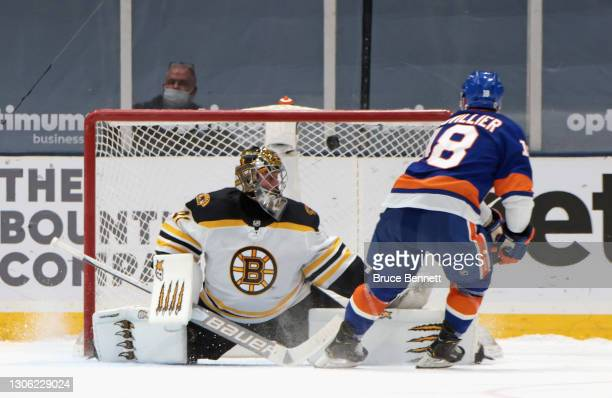 Anthony Beauvillier of the New York Islanders scores in the shootout against Jaroslav Halak of the Boston Bruins at the Nassau Coliseum on March 09,...