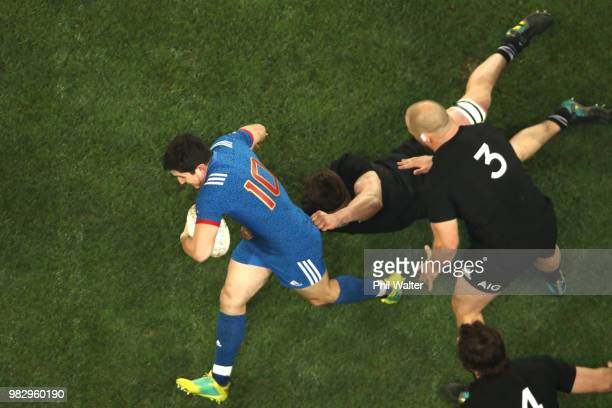 Anthony Belleau of France is tacked during the International Test match between the New Zealand All Blacks and France at Forsyth Barr Stadium on June...