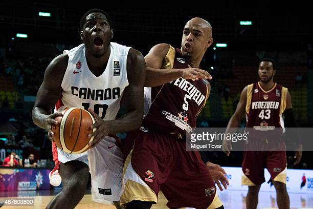 Anthony Bennett of Canada fights for the ball against Gregory Vargas of Venezuela during a semifinals match between Canada and Venezuela as part of...