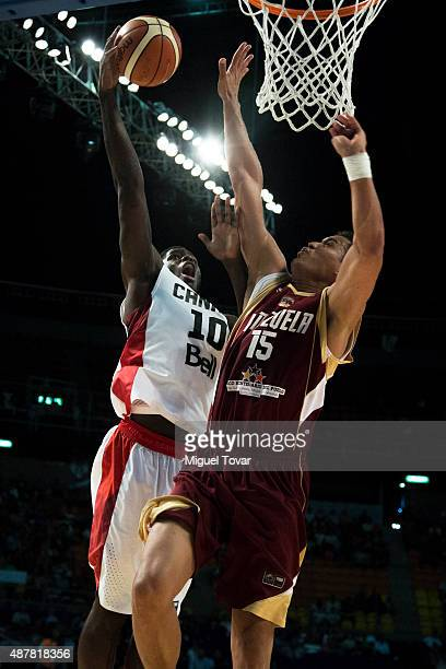 Anthony Bennett of Canada goes for the basket against Windi Graterol of Venezuela during a semifinals match between Canada and Venezuela as part of...