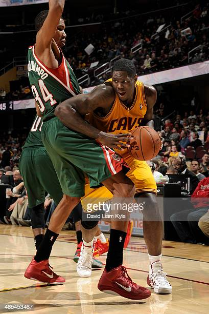 Anthony Bennett of the Cleveland Cavaliers drives to the basket against Giannis Antetokounmpo of the Milwaukee Bucks at The Quicken Loans Arena on...