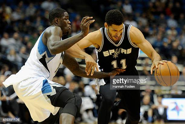 Anthony Bennett of the Minnesota Timberwolves defends against Jeff Ayres of the San Antonio Spurs during the fourth quarter of the game on November...